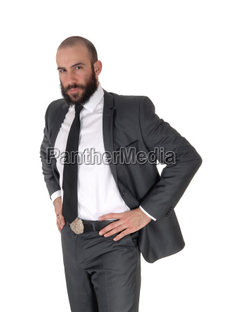 business man standing with hands on