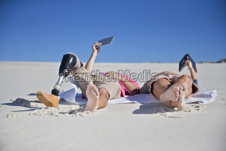 man with artificial leg lying on