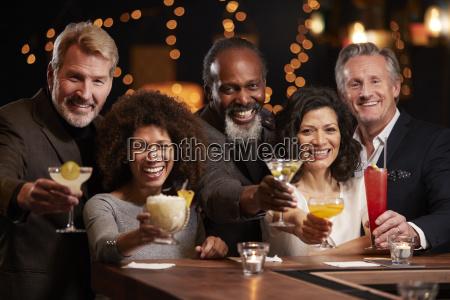 portrait of middle aged friends celebrating