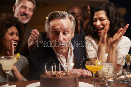 group of middle aged friends celebrating