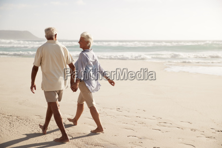 rear view of senior couple walking