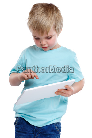 child little boy is typing on