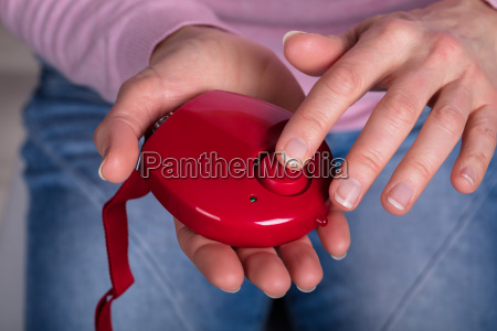woman pressing personal alarm button