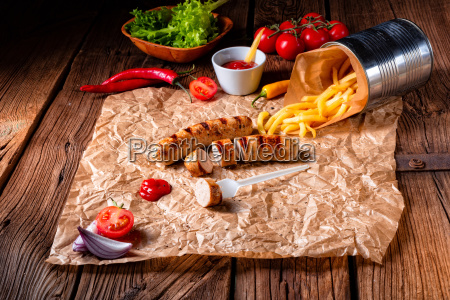 rustic bratwurst with pommes and hot