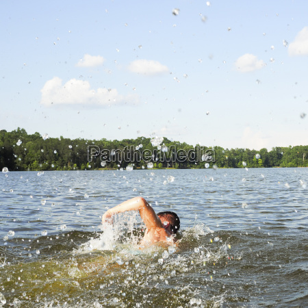 rear view of man swimming in
