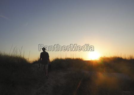 rear view of hiker walking on