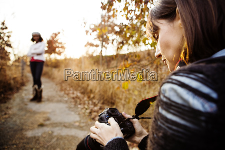 woman looking at photographs in digital