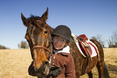portrait of happy boy with horse