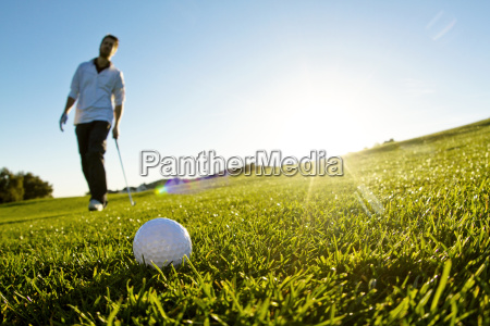 man standing on golf field against