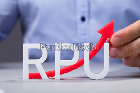 mans hand holding increasing red rpu