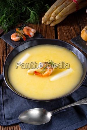 delicious asparagus cream soup with prawns