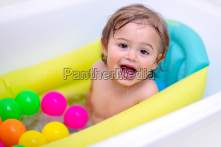 cute little boy bathing