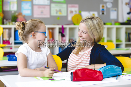 beautiful teacher helps her student to
