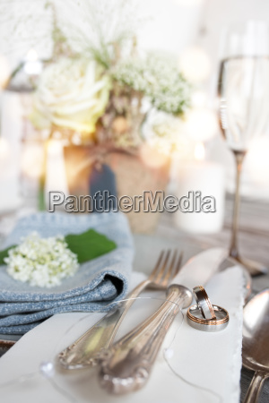 wedding rings on a table decoration
