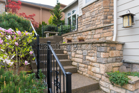 house front entry concrete stairs stone