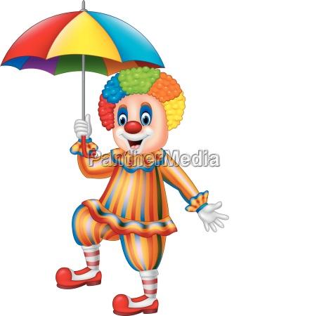 cartoon lustiger clown haelt einen regenschirm