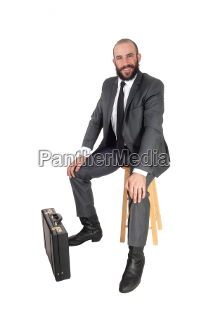 business man sitting with his and