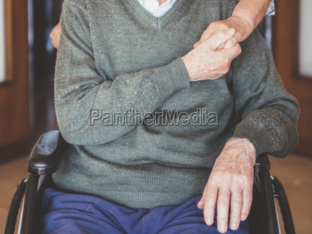 midsection of senior man holding woman