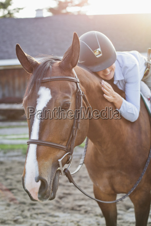 rancher lying on horse while riding