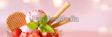 ice cream cup with strawberries and