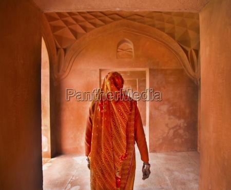 rear view of woman wearing orange