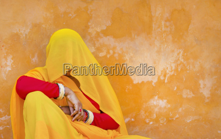 woman wearing red and yellow sari