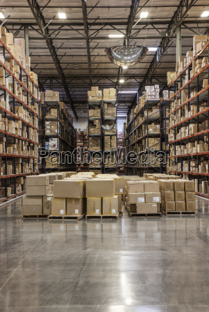 view down aisles of racks holding