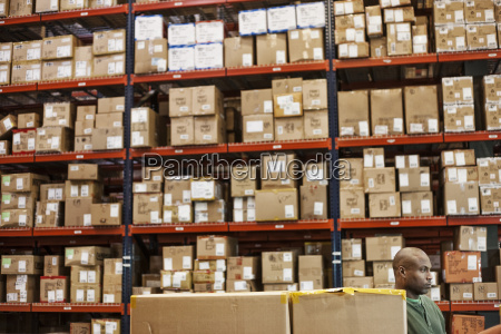 african american warehouse worker checking inventory