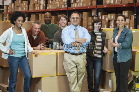 team portrait of multi ethnic warehouse