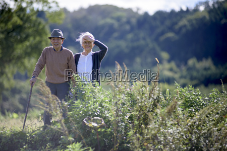 husband and wife elderly man wearing