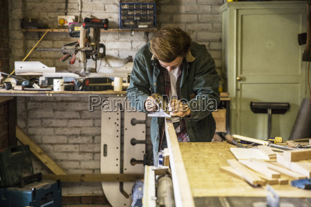 man working standing at a workbench