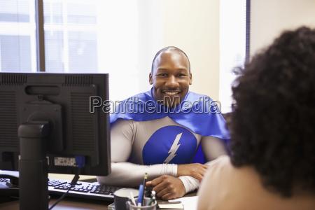 a black businessman office super hero