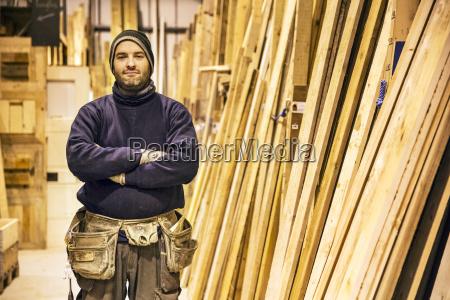bearded man wearing beanie and tool