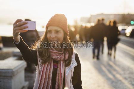 smiling mid adult woman taking selfie