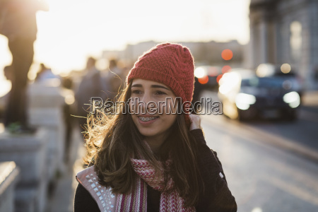 smiling mid adult woman wearing knit