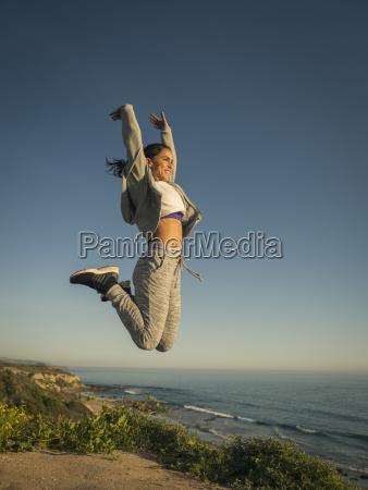 usa california newport beach woman jumping