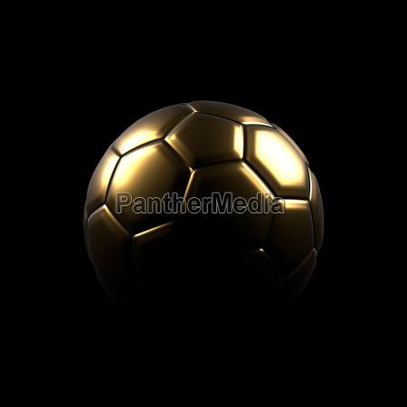 golden soccer ball on a black