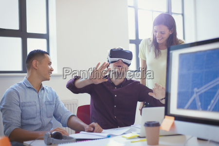 computer programmers testing virtual reality simulator