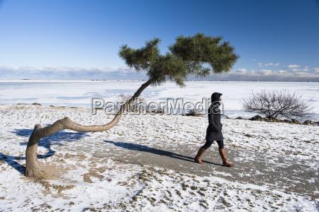 woman in warm clothing walking on