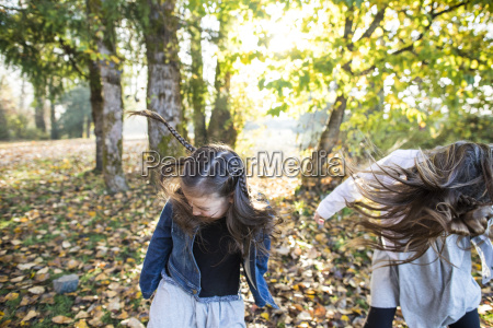 two girls playing in park