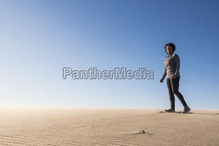 woman walking on beach newburyport massachusetts