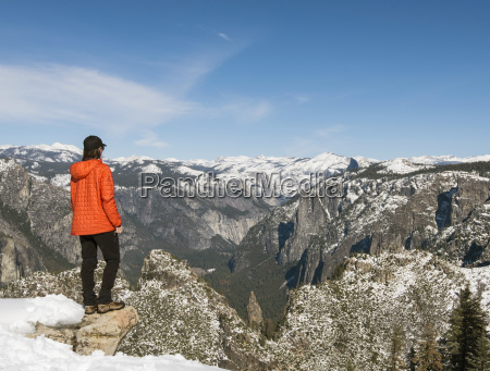 female hiker looking at view of