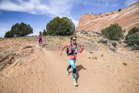 women trail running through grand staircase