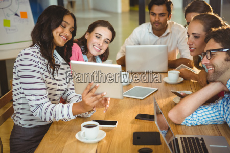 business executives using digital tablet during