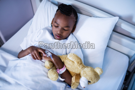 patient sleeping with teddy bear on