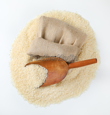 long grained rice wooden scoop and