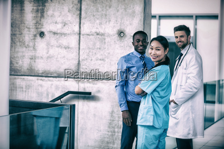 nurse and doctor with businessman standing