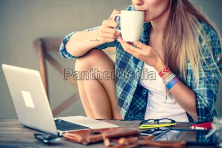 student girl drinking coffee
