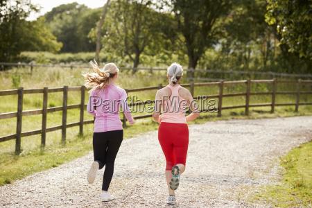 young and senior women enjoying run