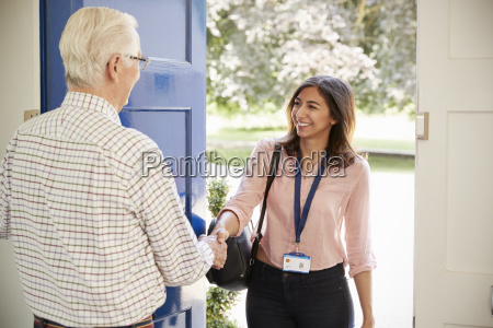 senior man greeting young woman making
